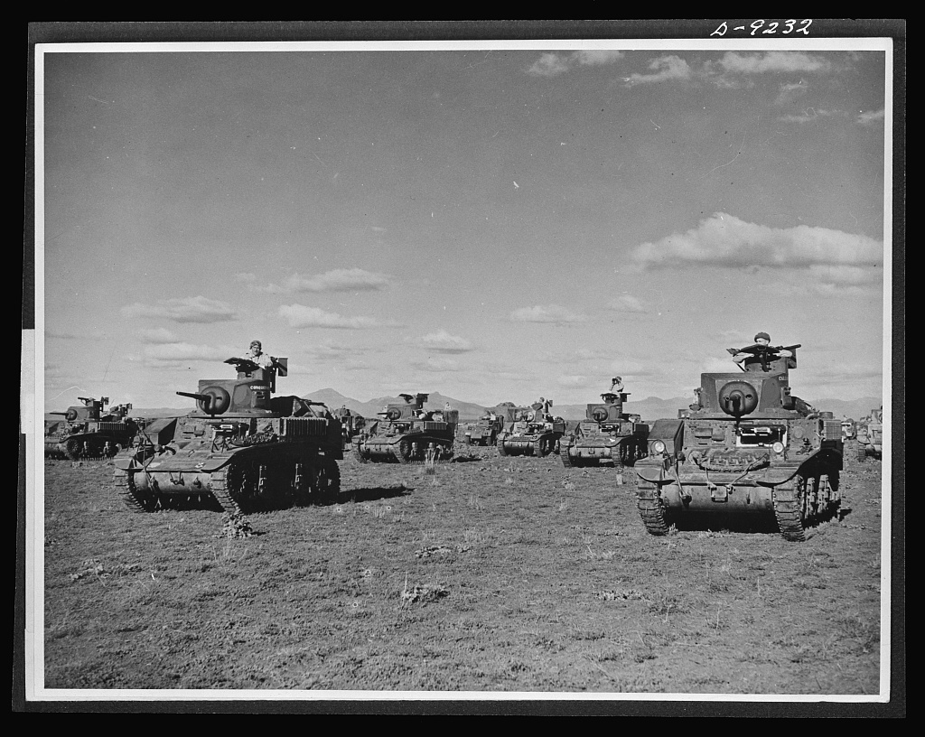 Australia in the war. American light tanks, manned by Australian crews, are playing an important role in the development of a formidable Australian mechanized army. The tanks shown here, provided by the United States under lend-lease, are being used in training armored crews