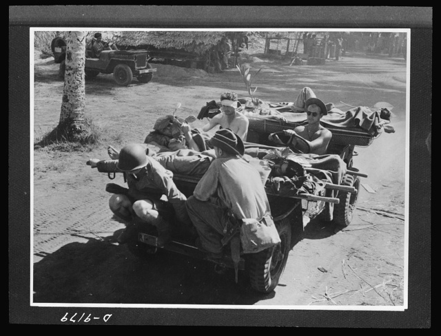 Australia in the war. An American jeep serves as an ambulance for Australian troops in New Guinea. The versatile little car carries wounded men on stretchers back to the base