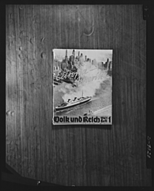 Axis propaganda. This is one of the Nazi propaganda booklet whicb Elmer Davis, director of the Office of War Information, displayed at his press conference on March 6, 1943. Note that the Nazis have used a photo of the New York skyline for their purposes. Mr. Davis said the Office of War Information (OWI) was combatting Nazi propaganda overseas with publications describing the democratic way to life