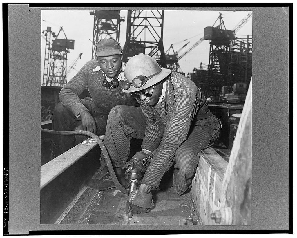 Baltimore, Maryland. A chipper removing excess metal from a welded seam during the construction of the Liberty ship Frederick Douglass at the Bethlehem-Fairfield shipyards