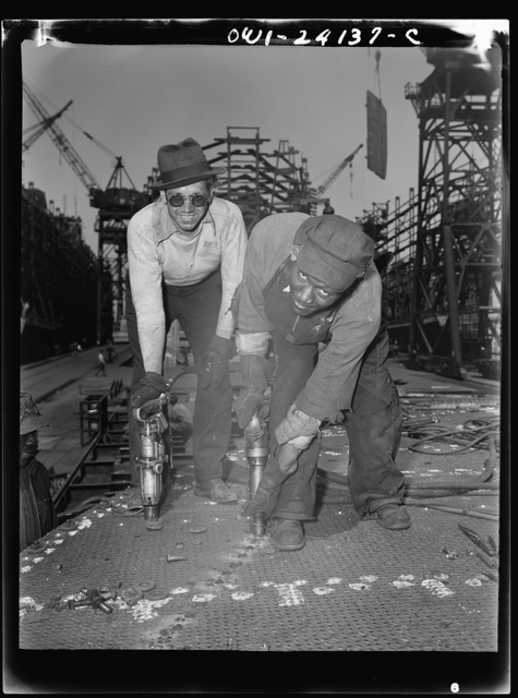 Baltimore, Maryland. Building the SS Frederick Douglass. More than 6,000 Negro shipyard workers are employed at the Bethlehem-Fairfield shipyards, where the Liberty ship is being rushed to completion. The noted orator and abolitionist leader worked as a ship caulker in the vicinity of this yard before he escaped from slavery. Riveters Dave Martin and Walter Shired pose for cameraman