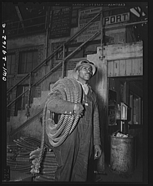 Baltimore, Maryland. Building the SS Frederick Douglass. More than 6,000 Negro shipyard workers are employed at the Bethlehem-Fairfield shipyards where the Liberty ship is being rushed to completion. The noted orator and abolitionist worked as a ship caulker in the vicinity of this yard before he escaped from slavery. James Bibons, soldier in the battle of production, carrying insulated electric cables for engine room