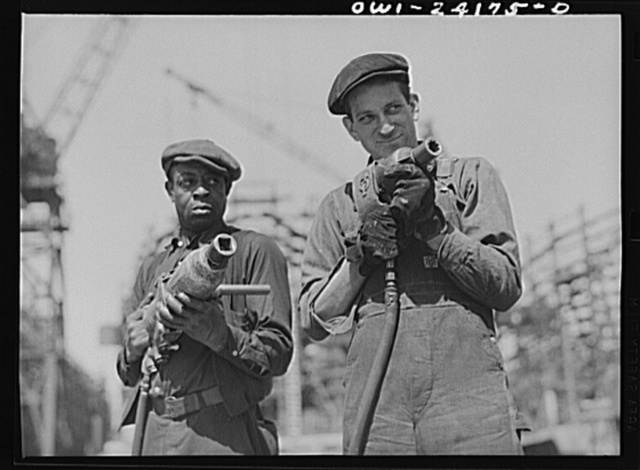 Baltimore, Maryland. Building the SS Frederick Douglass. More than 6,000 Negro shipyard workers are employed at the Bethlehem-Fairfield shipyards, where the Liberty ship is being rushed to completion. The noted orator and abolitionist leader worked as a ship caulker in the vicinity of this yard before he escaped from slavery. Oscar Sean and Jerry Evans holding machines used for bolting up