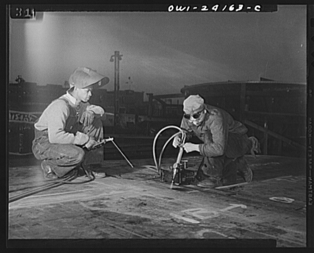Baltimore, Maryland. Building the SS Frederick Douglass. More than 6,000 Negro shipyard workers are employed at the Bethlehem-Fairfield shipyards where the Liberty ship is being rushed to completion. The noted orator and abolitionist worked as a ship caulker in the vicinity of this yard before he escaped from slavery. Electric Welder Bill Seward and Plate Burner John Smith in Layout Department of way no. 8