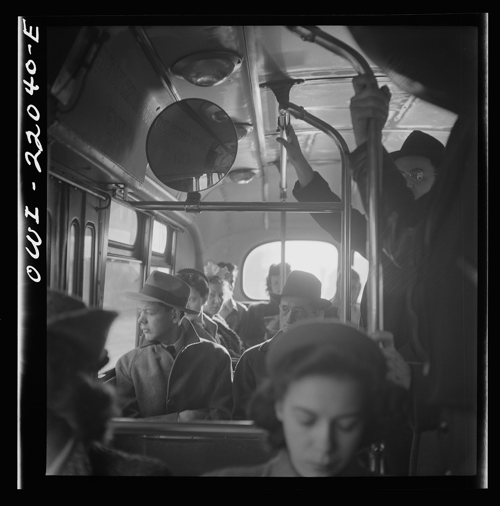 Baltimore, Maryland. Crowded bus carrying people to work at eight a.m.