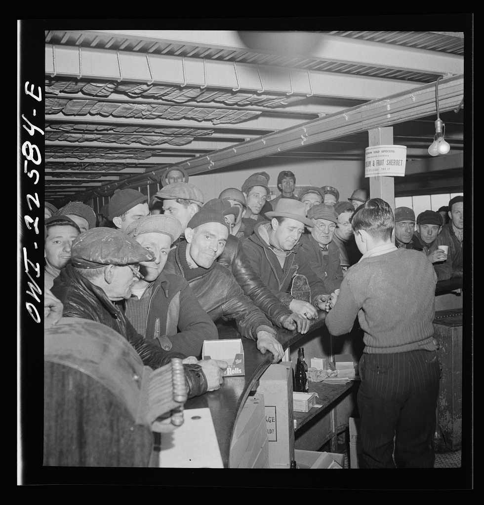 Baltimore, Maryland. Eighteen hundred workers are carried from the Bethlehem Fairfield shipyard to Baltimore on a former Wilson Line pleasure boat. The trip takes twenty minutes drinks