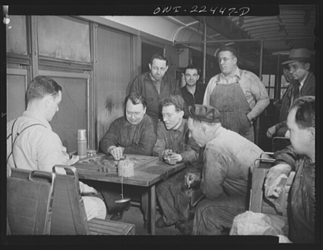 Baltimore, Maryland. Employees at the maintenance terminal of the Baltimore Transit Company having lunch and playing checkers in an old trolley made into a smoker