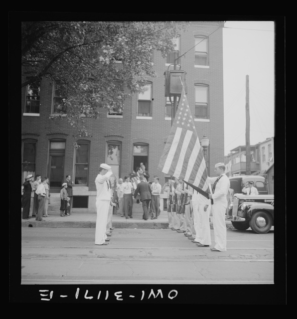 Baltimore, Maryland. Funeral of a merchant seaman. Pallbearers with flag-covered casket