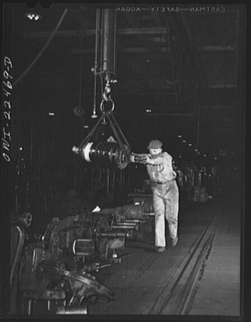 Baltimore, Maryland. Hauling armature of a trolley motor to be overhauled at the amature shop at the Washington terminal, maintenance plant of the Baltimore Transit Company