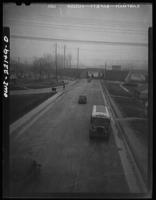 Baltimore, Maryland. Highway outside the Glenn L. Martin plant with cars arriving for the seven a.m. shift. Well-planned roads, and time staggering have eliminated heavy traffic