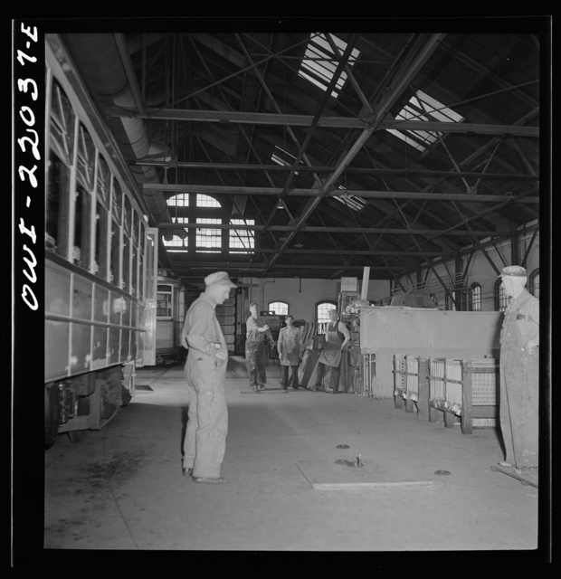 Baltimore, Maryland. Pitching horse shoes during lunch hour at the paint shop of the maintenance terminal of the Baltimore Transit Company