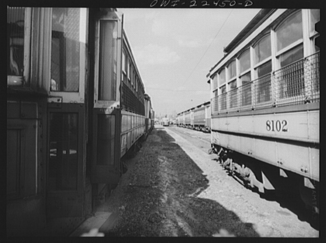 Baltimore, Maryland. The yard of Washington terminal, maintenance plant of the Baltimore Transit Company. Most of these trolleys can be reconditioned for use if wartime needs so require. In the distance are trackless trolleys