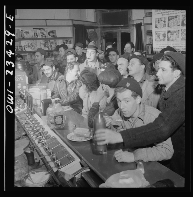 Baltimore, Maryland. Third shift defense workers getting snack at drugstore on corner where their shared car will pick them up around midnight