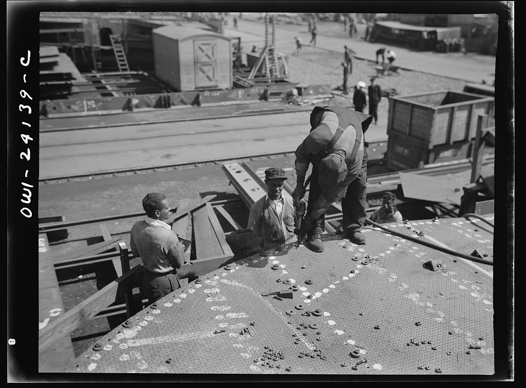 Baltimore, Maryland. Tightening bolts with a pneumatic wrench during the construction of the Liberty ship Frederick Douglas at the Bethlehem-Fairfield shipyards