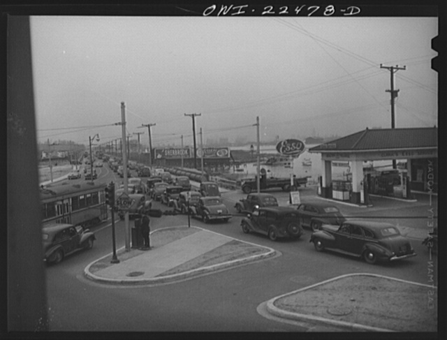 Baltimore, Maryland. Traffic jam as workers of the first shift leave the Belthlehem Fairfield shipyards in cars and trolleys on the road to Baltimore