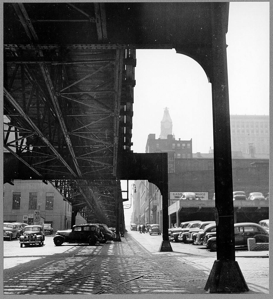 Baltimore, Maryland. Under the elevated trolley. The Baltimore Trust building is in the distance