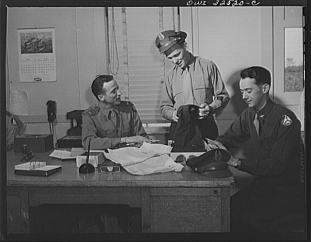 Bar Harbor, Maine. Civil Air Patrol base headquarters of coastal patrol no. 20. Flyers purchasing uniforms in the administration office