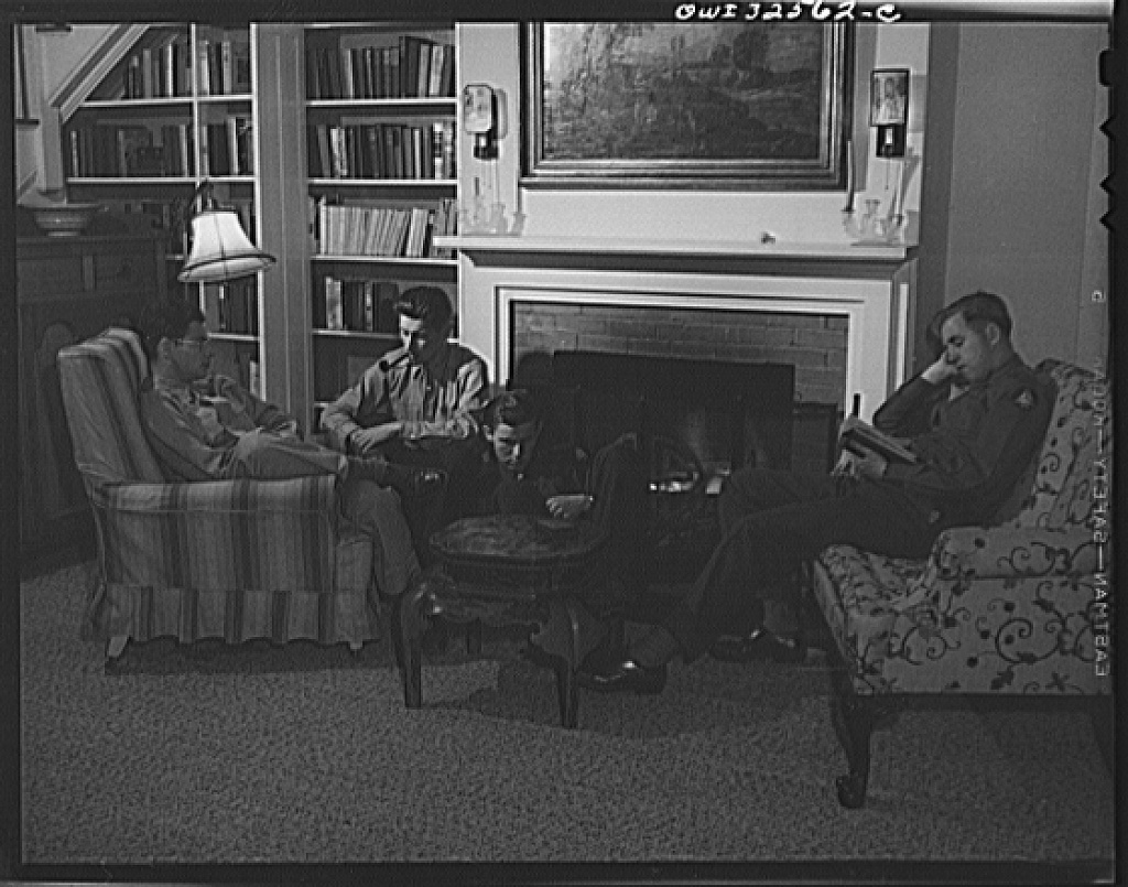 Bar Harbor, Maine. Civil Air Patrol base headquarters of coastal patrol no. 20. Flyers relaxing in a luxurious summer home which they were able to rent for very little in the deserted Bar Harbor summer resort