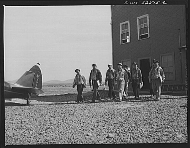 Bar Harbor, Maine. Civil Air Patrol base headquarters of coastal patrol no. 20. Dusk patrol leaving the intelligence room to go to their planes