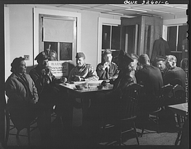 Bar Harbor, Maine. Civil Air Patrol base headquarters of coastal patrol no. 20. Personnel warming up in the canteen before the dawn patrol. The woman at the near end of the table works in the control tower