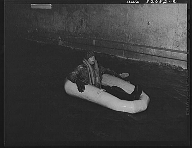 Bar Harbor, Maine. Civil Air Patrol base headquarters of coastal patrol no. 20. Testing a rubber crash boat in the swimming pool