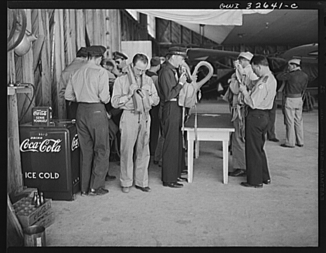 """Bar Harbor, Maine. Civil Air Patrol base headquarters of coastal patrol no. 20. Routine inspection of """"Mae Wests,"""" life-preserving vests worn by flyers on all patrols over water"""