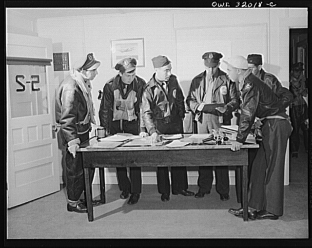Bar Harbor, Maine. Civil Air Patrol base headquarters of coastal patrol no. 20. Pilots and observers getting instruction before taking off on dawn patrol