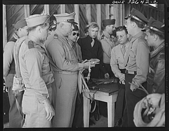 "Bar Harbor, Maine. Civil Air Patrol base headquarters of coastal patrol no. 20. Major J.B. King, base commander, inspecting ""Mae West"" life preservers"