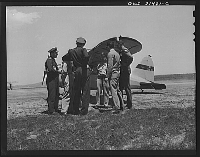 Bar Harbor, Maine. Civil Air Patrol base headquarters of coastal patrol no. 20. Pilots and observers talking things over