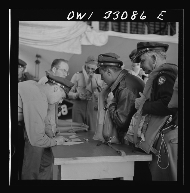 "Bar Harbor, Maine. Civil Air Patrol base headquarters of coastal patrol no. 20. Routine check of ""Mae West"" life preservers"