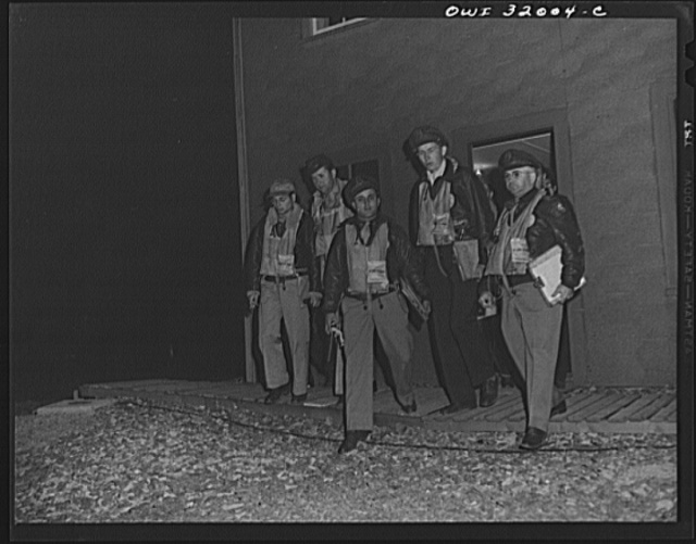 Bar Harbor, Maine. Civil Air Patrol base headquarters of coastal patrol no. 20. Pilots and observers leaving the intelligence room to take off for dawn patrol at 4 a.m.