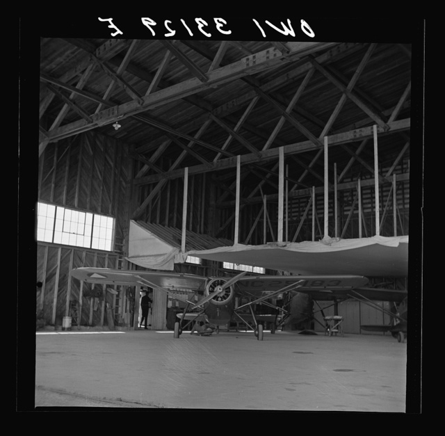 Bar Harbor, Maine. Civil Air Patrol base headquarters of coastal patrol no. 20. The false ceiling in the background of the hangar covered with canvas is for heating up the planes in winter