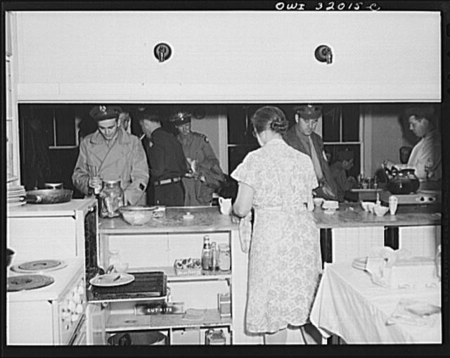 Bar Harbor, Maine. Civil Air Patrol base headquarters of coastal patrol no. 20. Dawn patrol warming up in the canteen at 3 a.m.