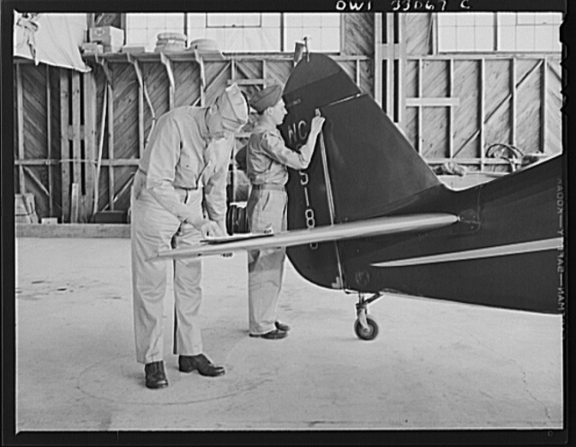 Bar Harbor, Maine. Civil Air Patrol base headquarters of coastal patrol no. 20. Ground crew mechanics overhauling a tail assembly during routine check-over