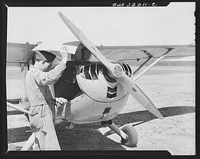 Bar Harbor, Maine. Civil Air Patrol base headquarters of coastal patrol no. 20. Ground crew making a routine overhaul of a patrol plane