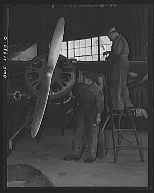 Bar Harbor, Maine. Civil Air Patrol base headquarters of coastal patrol no. 20. Ground crew making routines overhaul of a patrol plane