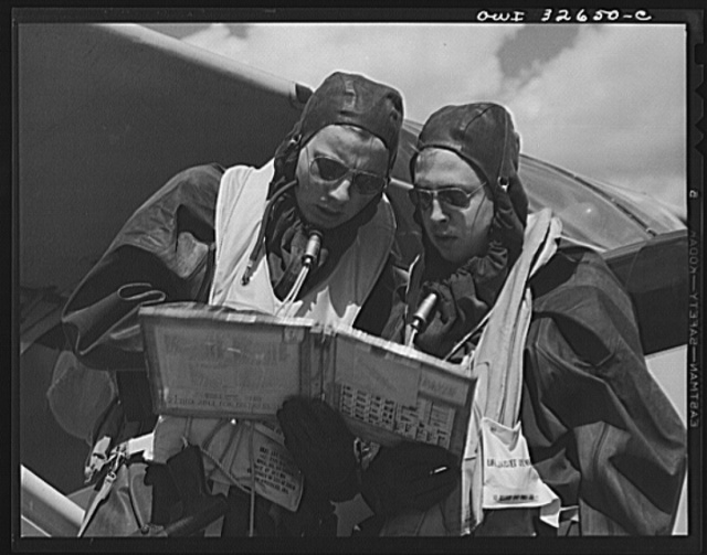 Bar Harbor, Maine. Civil Air Patrol base headquarters of coastal patrol no. 20. A pilot and an observer dressed in rubber crash suits worn by fliers throughout the winter months