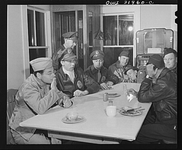 Bar Harbor, Maine. Civil Air Patrol base headquarters of coastal patrol no. 20. Dawn patrol warming up in the canteen before taking off at 4 a.m.