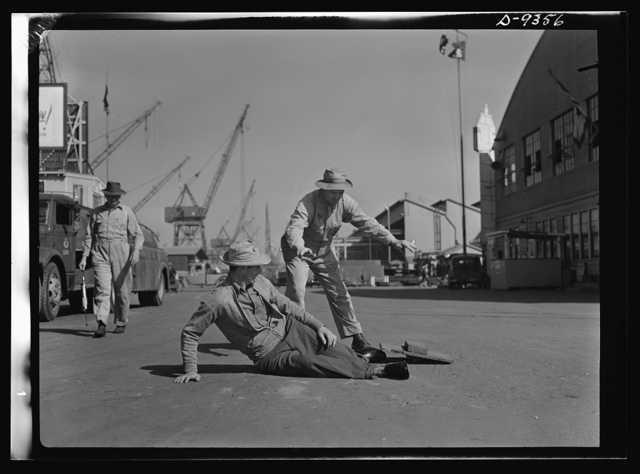 "Baseball players in war production. ""Safe,"" signals George Stovall, retired manager of the Cleveland Indians as Vince DiMaggio slides home during a lunch-hour softball game in the California Shipbuilding Corporation shipyards. DiMaggio, Pittsburgh Pirates outfielder, has been a warehouseman at the California shipyards since last fall; Stovall has worked as checker in the yards for more than a year"
