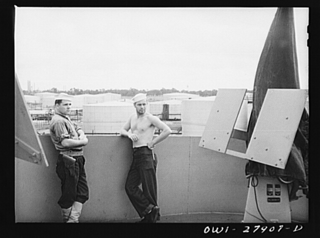 Baytown, Texas. Merchant marinemen on a tanker which is loading oil at a refinery