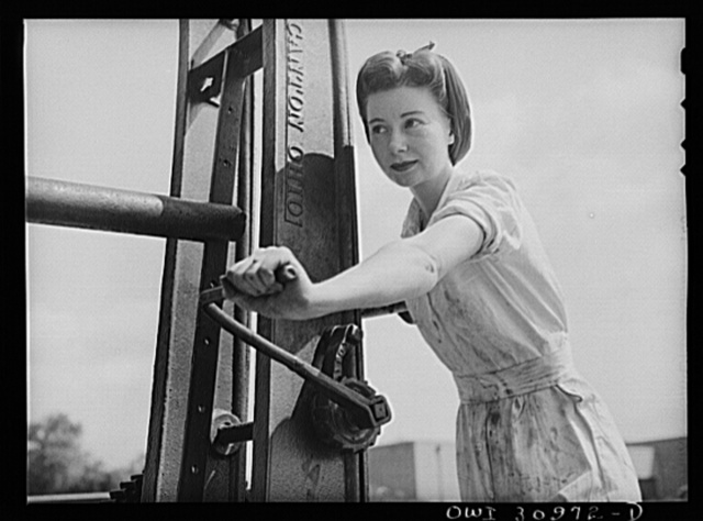 Beaumont, Texas. Dorothy Mason, a mechanic for the city transit company operating a hoist