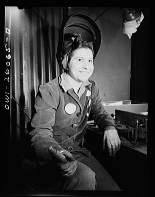 Bell Aircraft Corporation, Niagara Falls, New York. Woman welder who has been welding the ejection chutes of fifty callibre machine guns