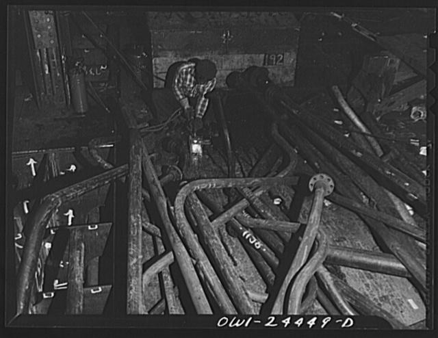 Bethlehem-Fairfield shipyards, Baltimore, Maryland. A burner at work in the engine room