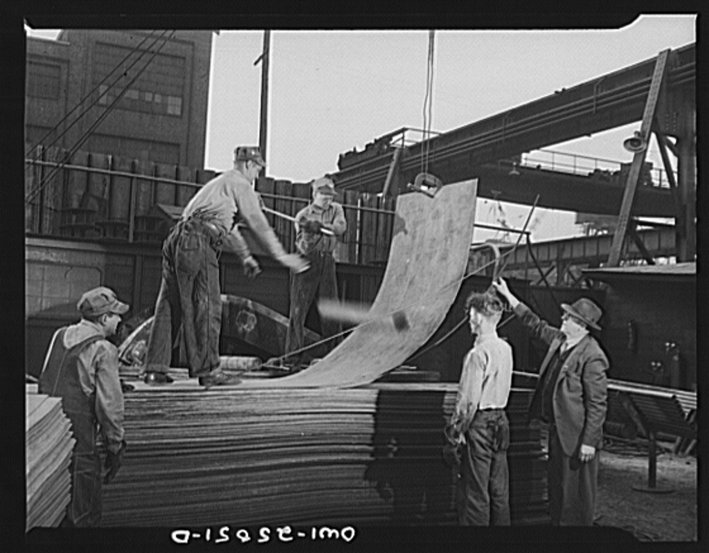 Bethlehem-Fairfield shipyards, Baltimore, Maryland. Bending copper sheeting by hammering and throwing steel billet at the sheet