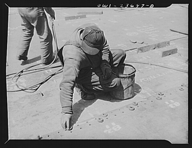Bethlehem-Fairfield shipyards, Baltimore, Maryland. Bolting up bottom shell plating