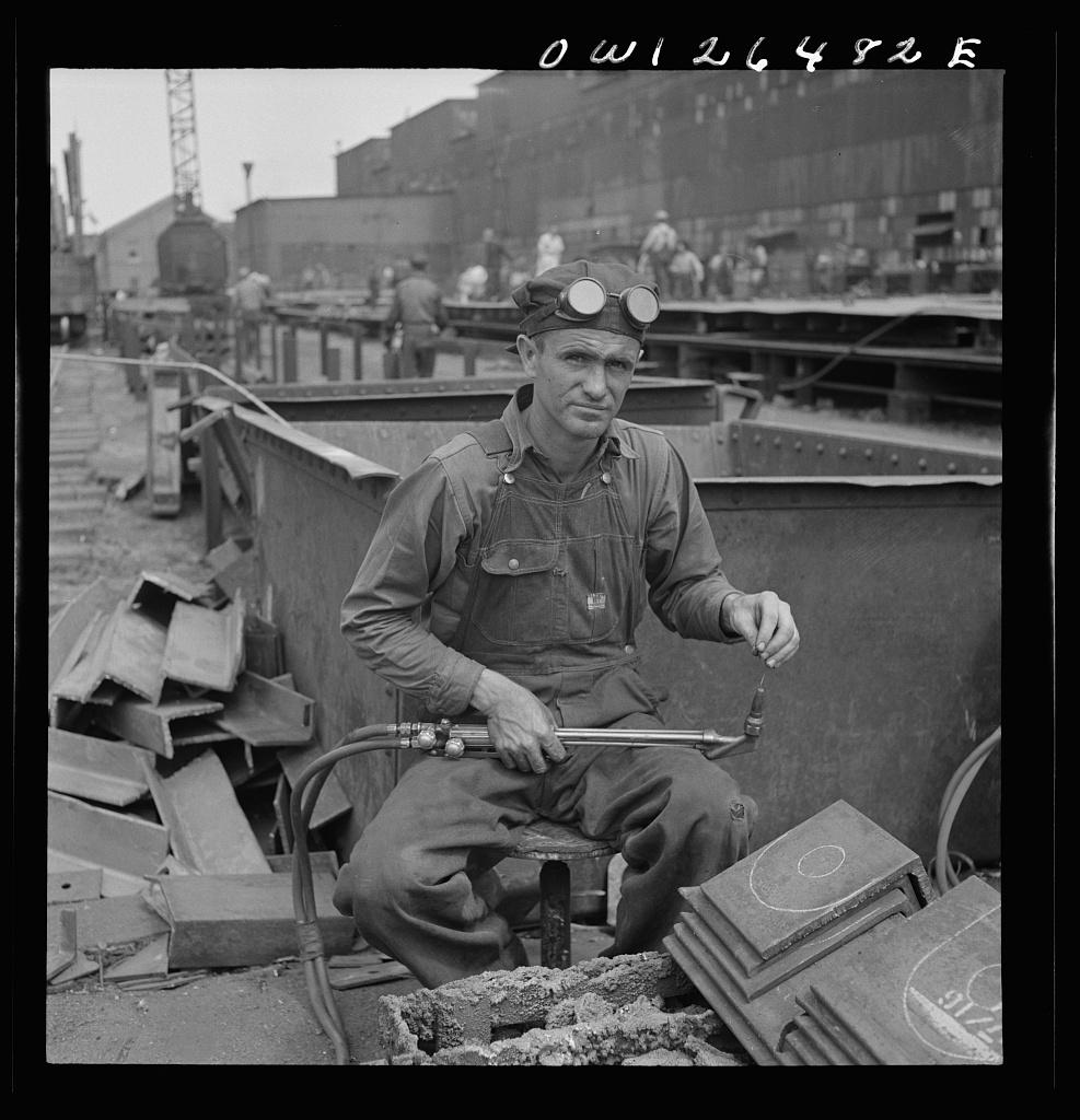 Bethlehem-Fairfield shipyards, Baltimore, Maryland. Burner with workmen