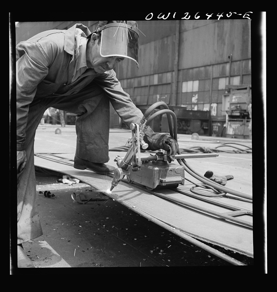 Bethlehem-Fairfield shipyards, Baltimore, Maryland. Burning off excess steel plate