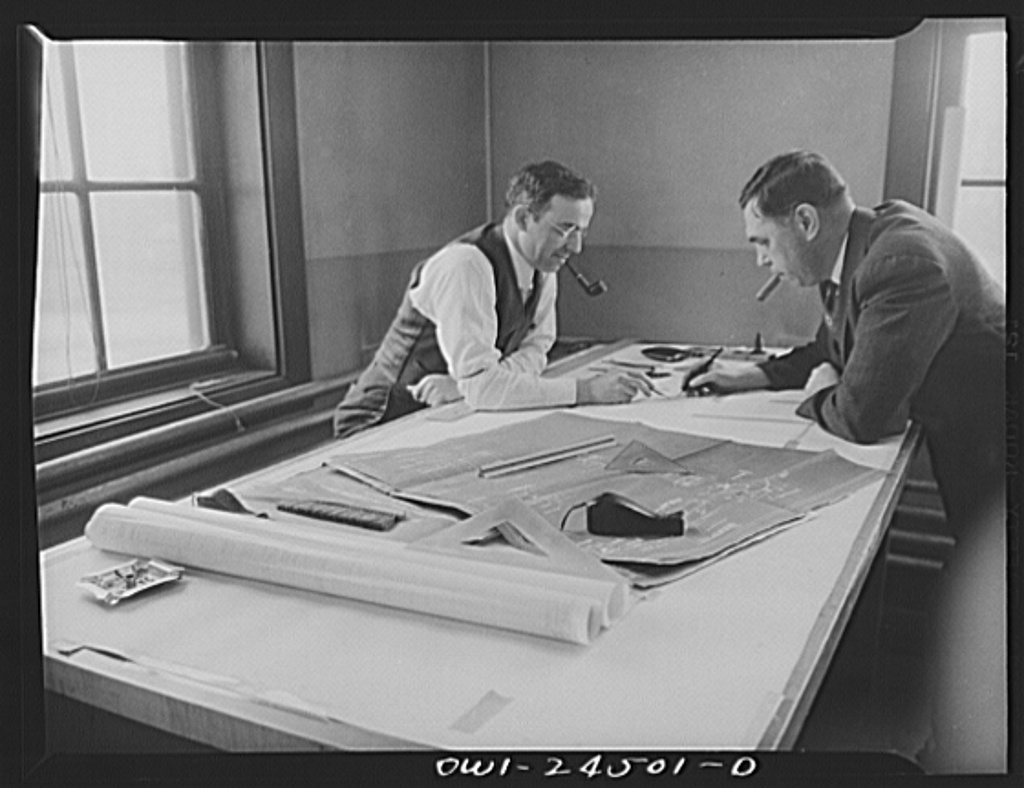 Bethlehem-Fairfield shipyards, Baltimore, Maryland. Discussing design changes in a drafting room