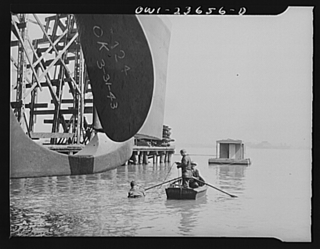 Bethlehem-Fairfield shipyards, Baltimore, Maryland. Diver inspecting outboard launching ways