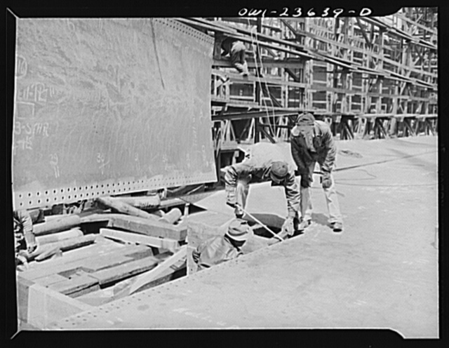 Bethlehem-Fairfield shipyards, Baltimore, Maryland. Erecting bottom shell plating